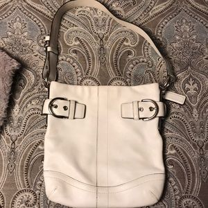 White coach purse.